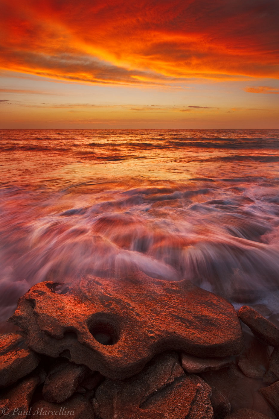 An amazing fiery sunrise over Washington Oaks' limestone formations. Rocky shorelines are not common in Florida and on the east...